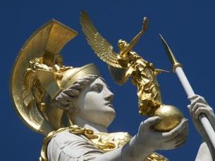 Close-up of statue of Greek Goddess Pallas Athena holding a miniature golden angel 305 x 229
